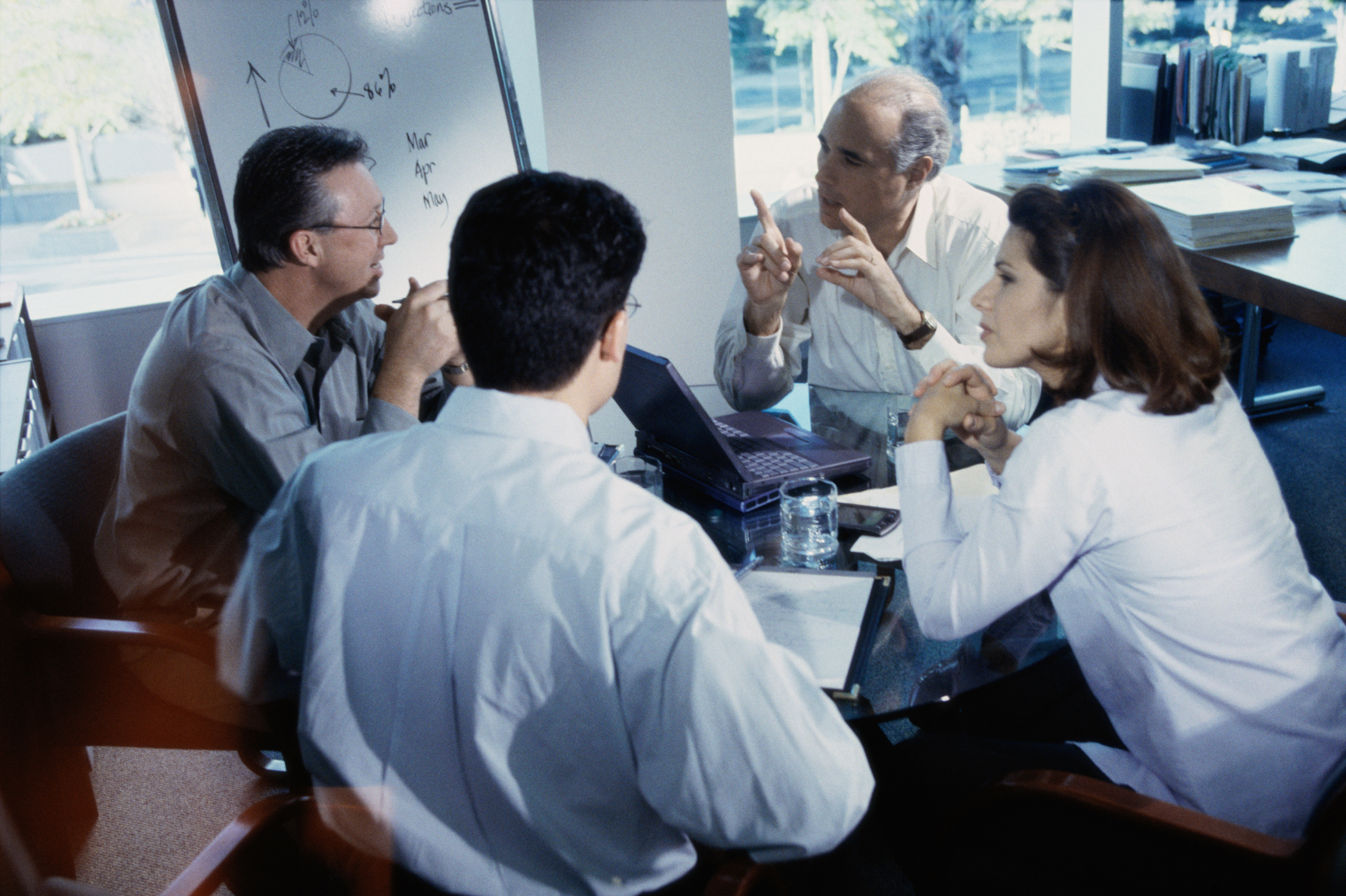business executives at a round table discussion